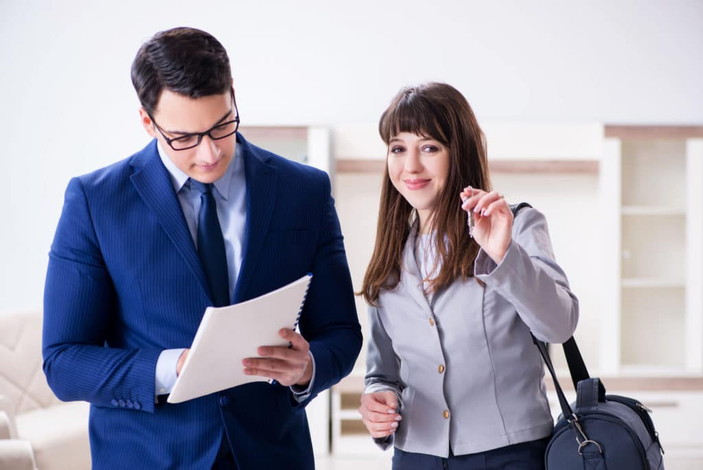 The Real Estate Agent Showing New Apartment To Owner Real Estate Agent Showing New Apartment To Owner