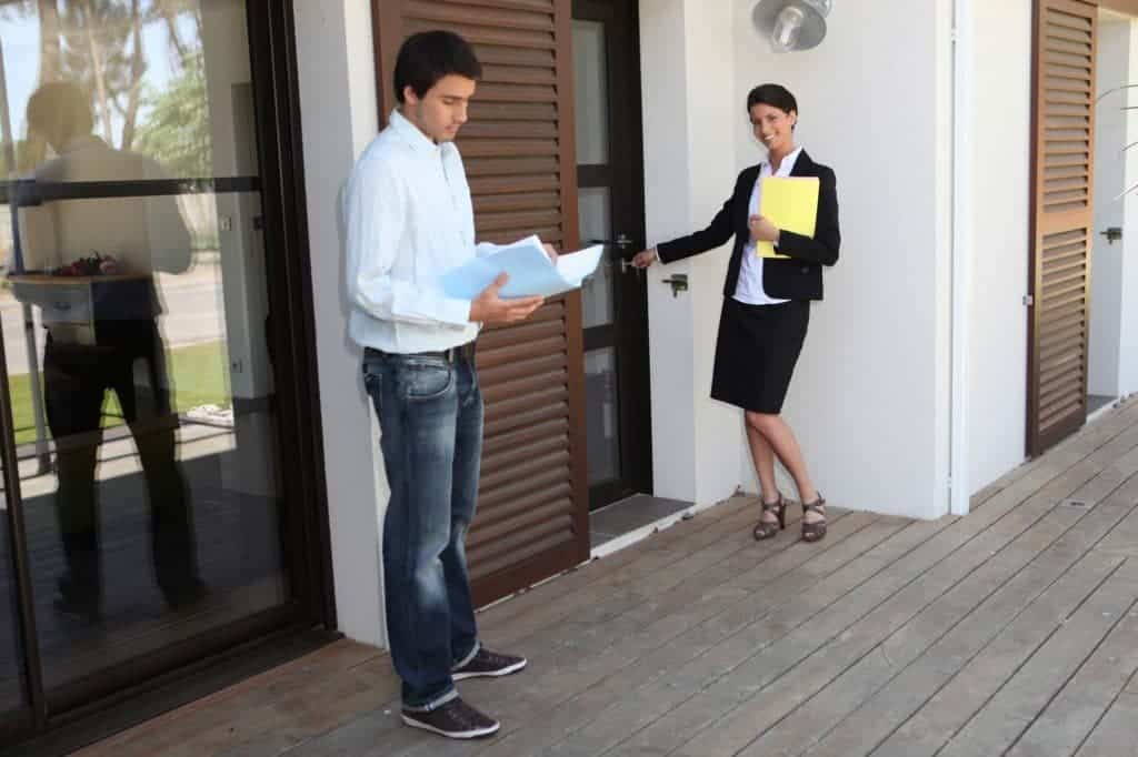 Real estate agent showing properties