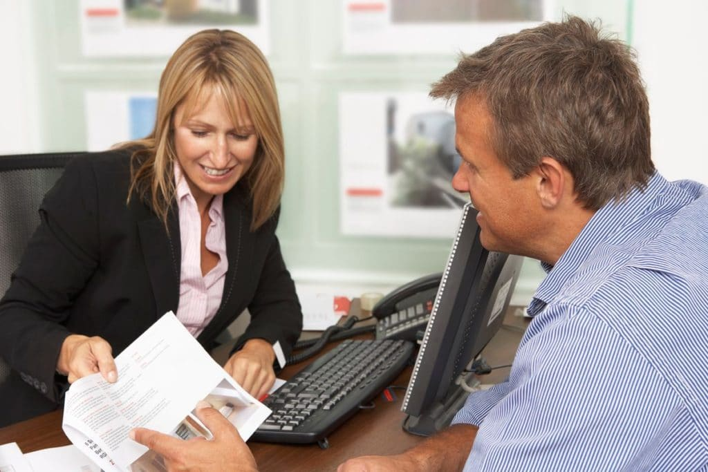Woman Real Estate Professional Meeting Client