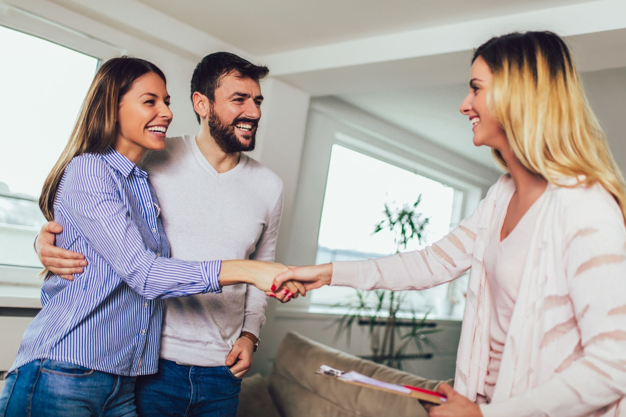 Real estate agent meeting couple clients