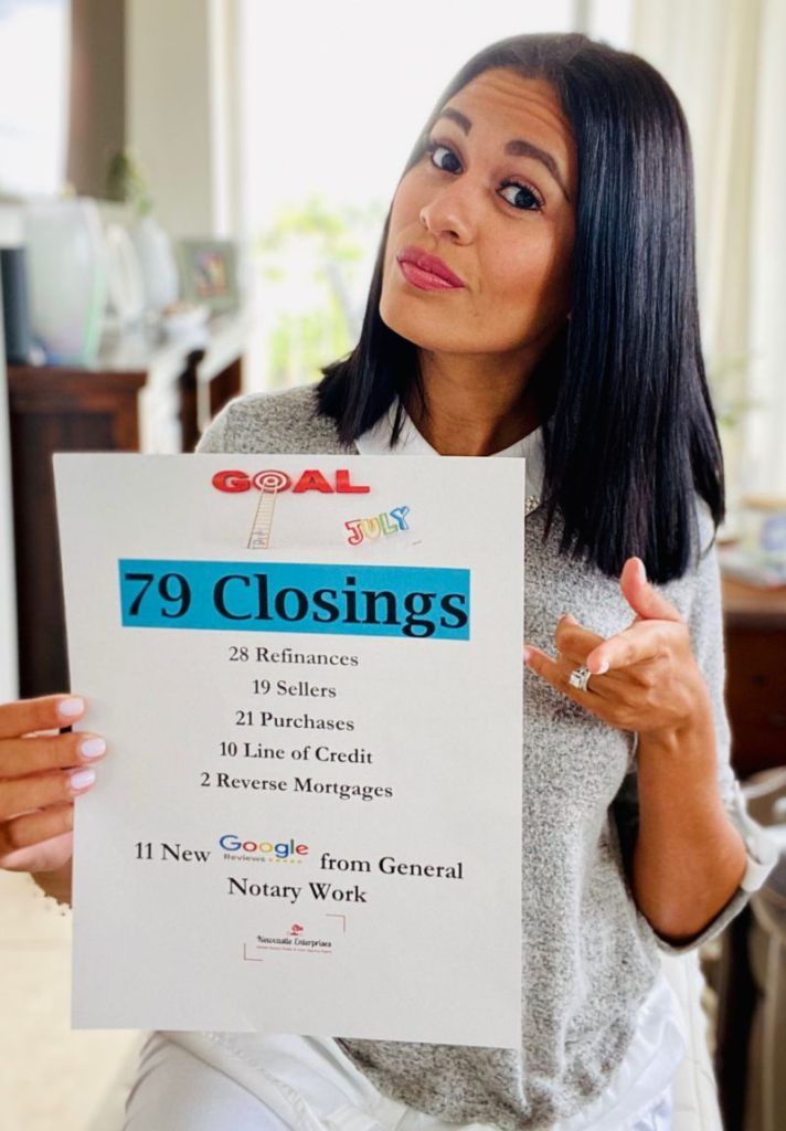 Luisa Cook Notary Public and Loan Signing Agent holding sign with successful notary business results