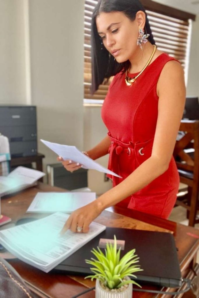Luisa Cook, Notary Public and Loan Signing Agent reviewing documents