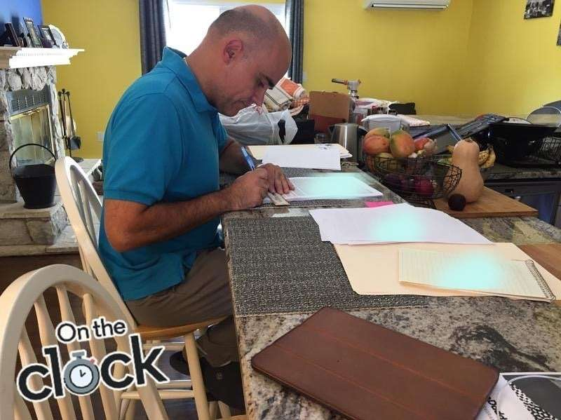 David Vidal, Notary Loan Signing Agent working on loan documents