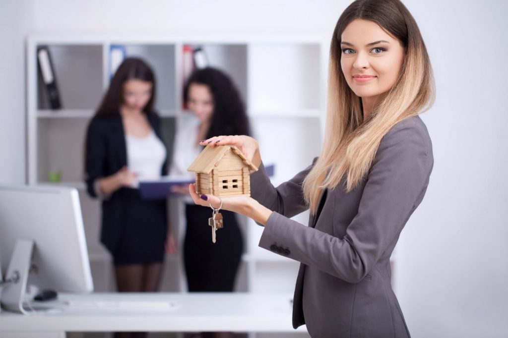 CT real estate agent working in office